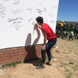 Maria signing wall